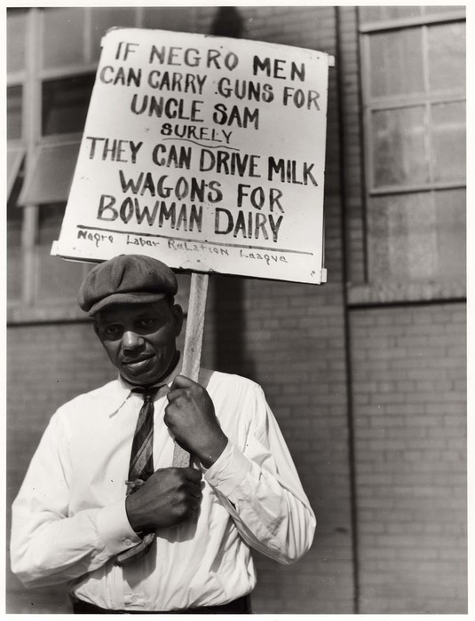 Carrying a sign in front of a milk company