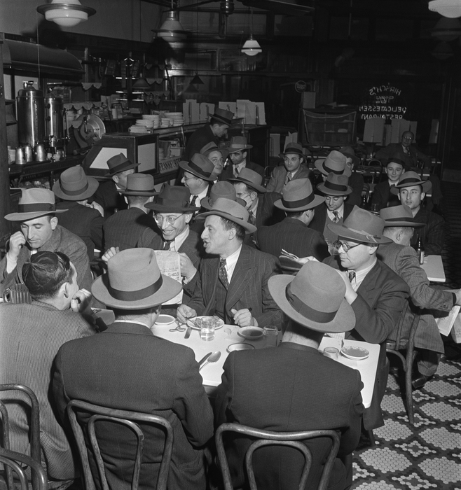 [Garment district executives eating and reading Yiddish newspapers, Hirsch's Kosher Delicatessen Restaurant, West 35th Street, New York]