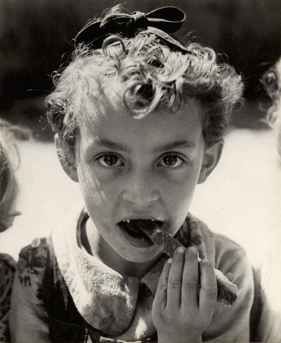 [Malnourished child eating a crust of bread in the TOZ (Society for Safeguarding the Health of the Jewish Population) summer camp in Otwock, near Warsaw]