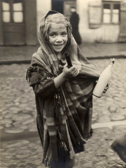 [Young girl returning from the store with a pot of soup and a bottle of milk, Lodz]