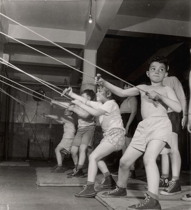 [Boys exercising in the gymnasium of the Jewish Community House of Bensonhurst, Brooklyn, New York]