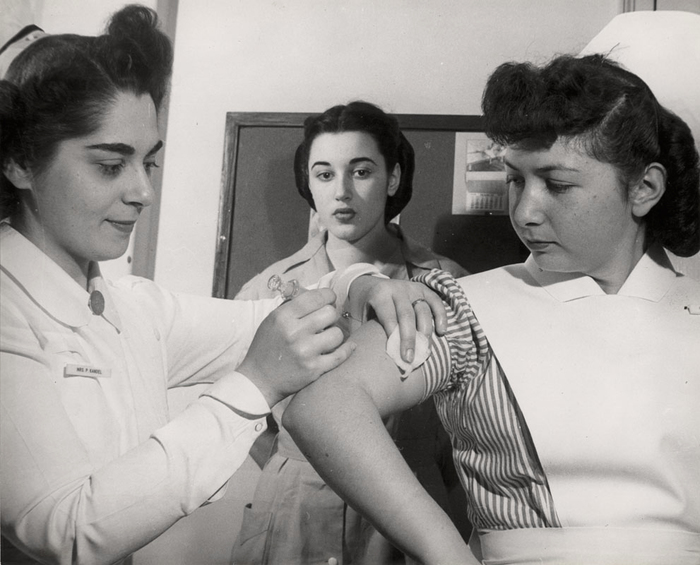 [Student nurses practicing their skills by giving each other injections, Jewish Hospital School of Nursing,<br /> Crown Heights, Brooklyn, New York]