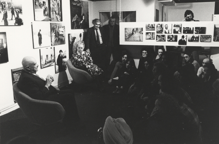 [Roman and Edith Vishniac with Cornell Capa (standing) responding to questions at The Concerned Photographer 2 exhibition, International Center of Photography, 1130 Fifth Avenue, New York]