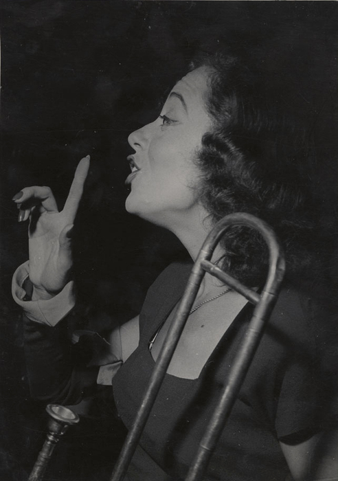 [Comedian Imogene Coca with trombone, Village Vanguard, Greenwich Village, New York]