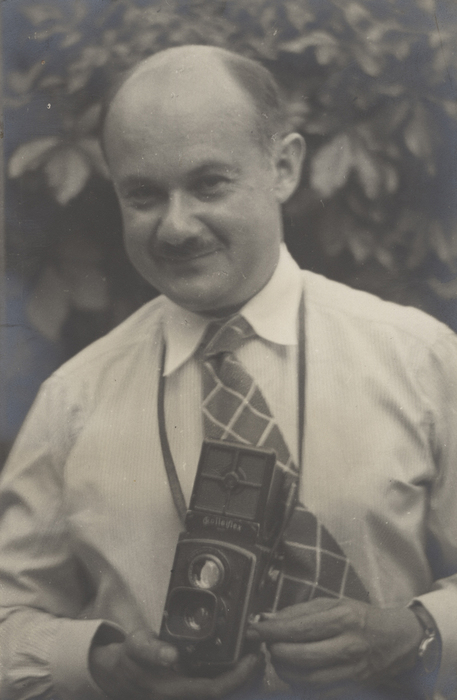 [Roman Vishniac holding his Rolleiflex camera, probably Germany]