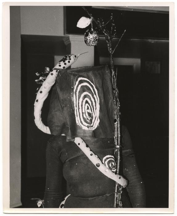 [woman wearing garden of eden costume]