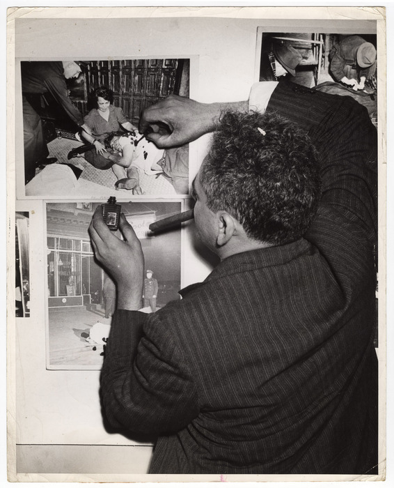 [Weegee touching up a photograph of Manuel Jiminez with nail polish for