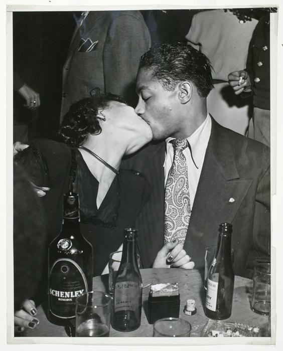 [Couple kissing]
