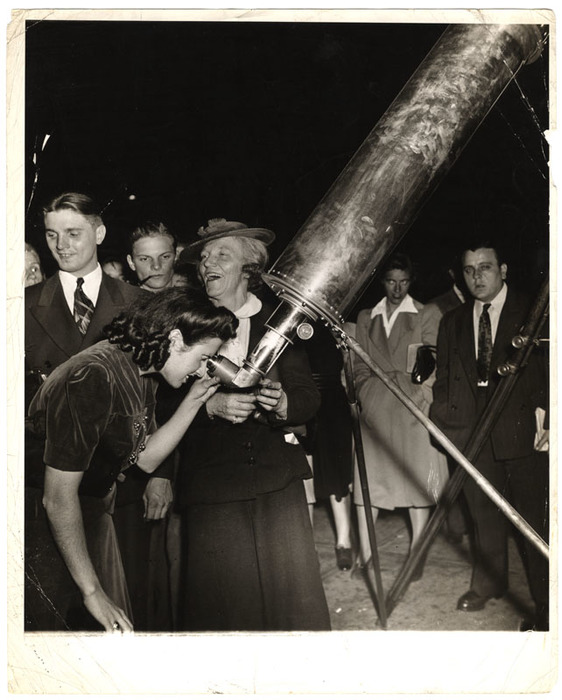 [Woman looking at Mars through telescope, Times Square, New York]