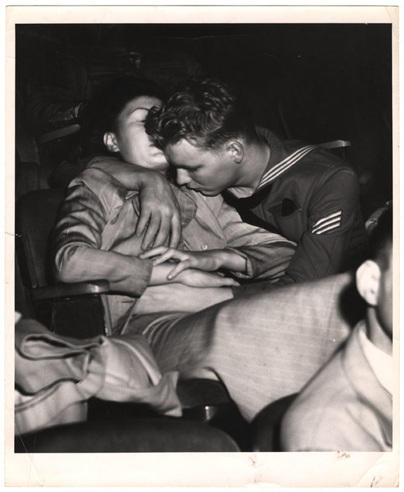 [Sailor and girl at the movies, New York]