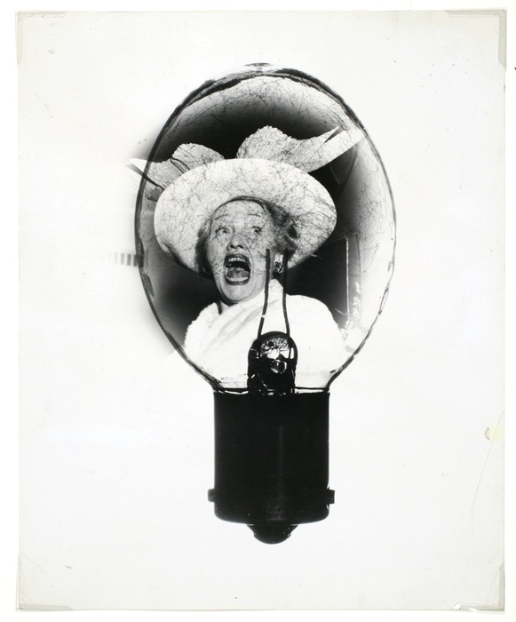 [Hedda Hopper in a flashbulb]