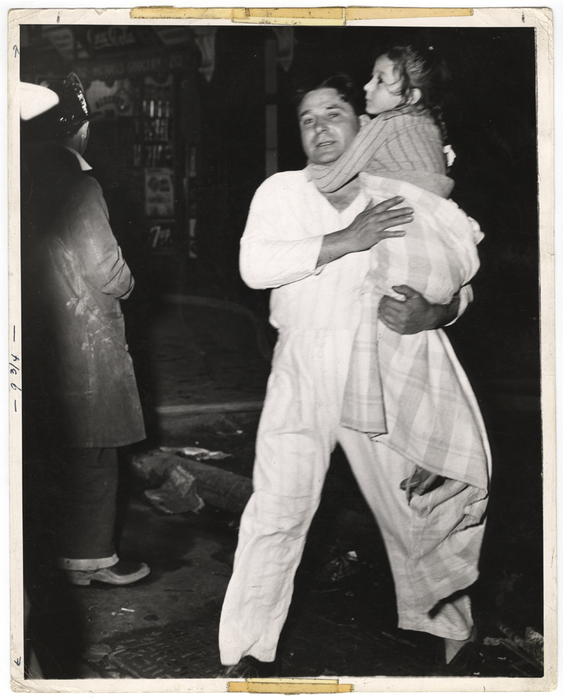 [Man rescuing girl from a fire, New York]