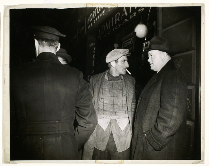 [Police with man caught at candy store, New York]