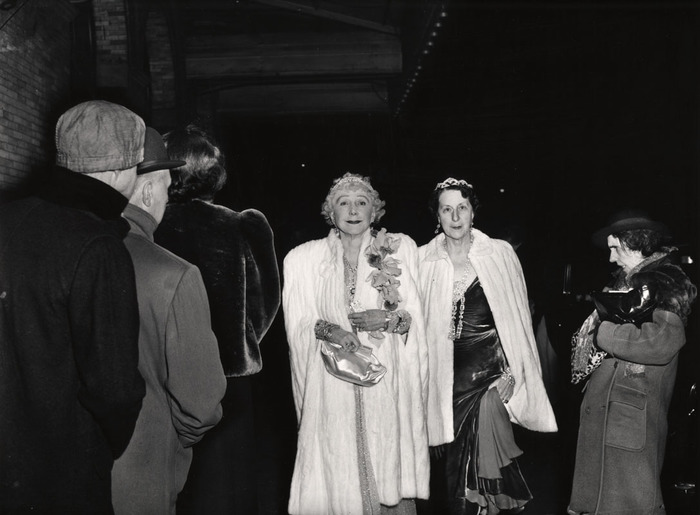 [Mrs. George Washington Kavanaugh and Lady Decies entering the opening night of the Metropolitan Opera's Diamond Jubilee, New York]