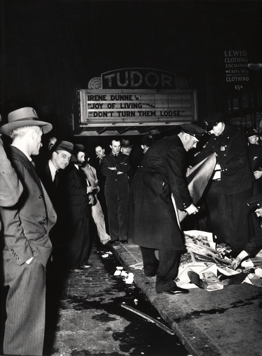 [Police and bystanders with body of Stanley Sandler, a passenger in an automobile that crashed into a Third Avenue El pillar and caught fire, New York]