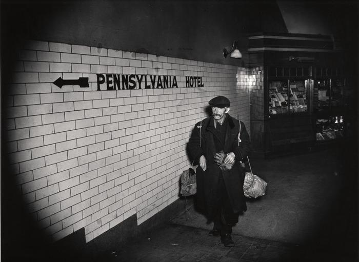 [Homeless man in underground passage, New York]