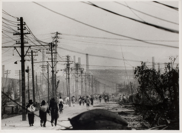 2,500 meters from epicenter, civilians flee and search for survivors, following dropping of atomic bomb on Nagasaki