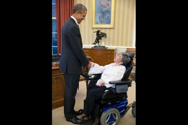 Alyce Dixon shaking hands with President Obama. Photo Courtesy of The White House