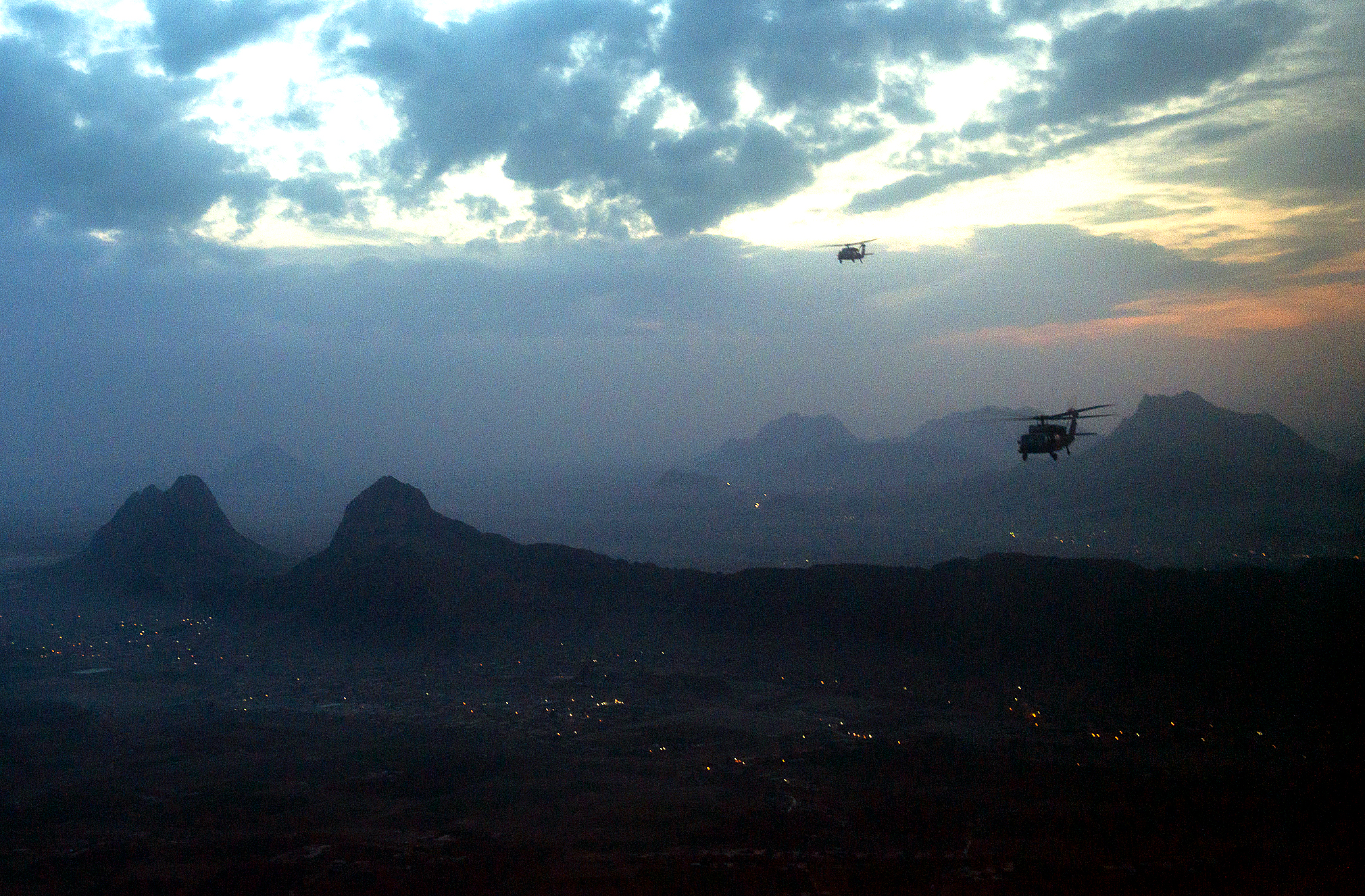 Blackhawk helicopters fly to Kandahar, Afghanistan, Dec. 16, 2012. DoD photo by D. Myles Cullen
