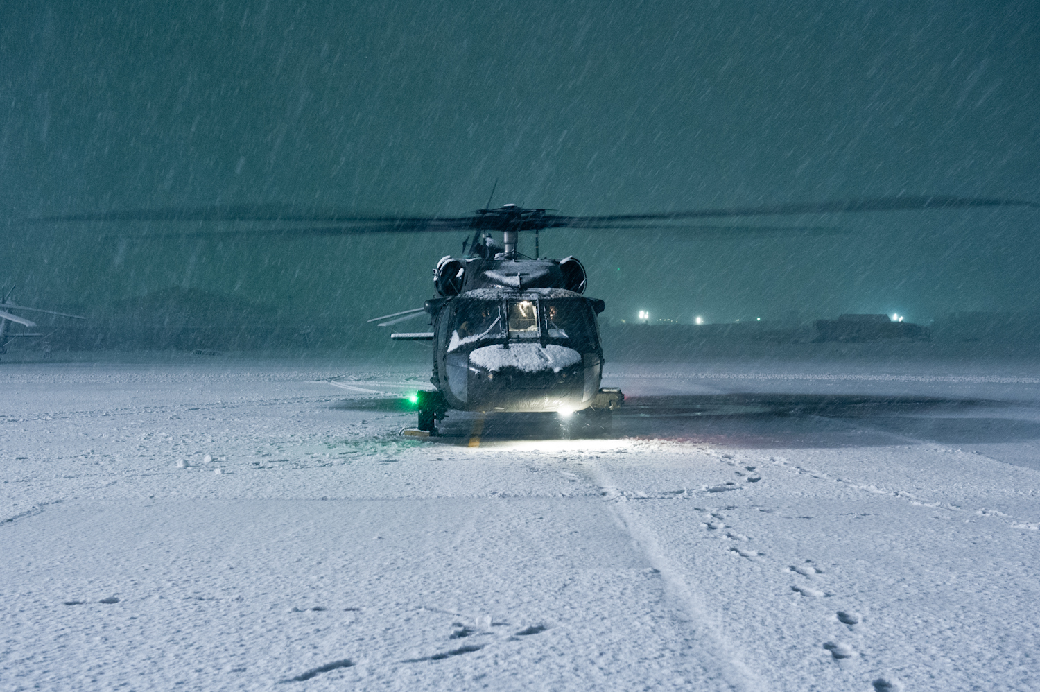 A UH-60 Black Hawk Helicopter with A Company, 5th Battalion, 101st Combat Aviation Brigade gets run up to ensure mission readiness during a snow storm on Bagram Airfield, Afghanistan Dec. 27. (U.S. Army photo by Sgt. Duncan Brennan, 101st CAB public affairs)