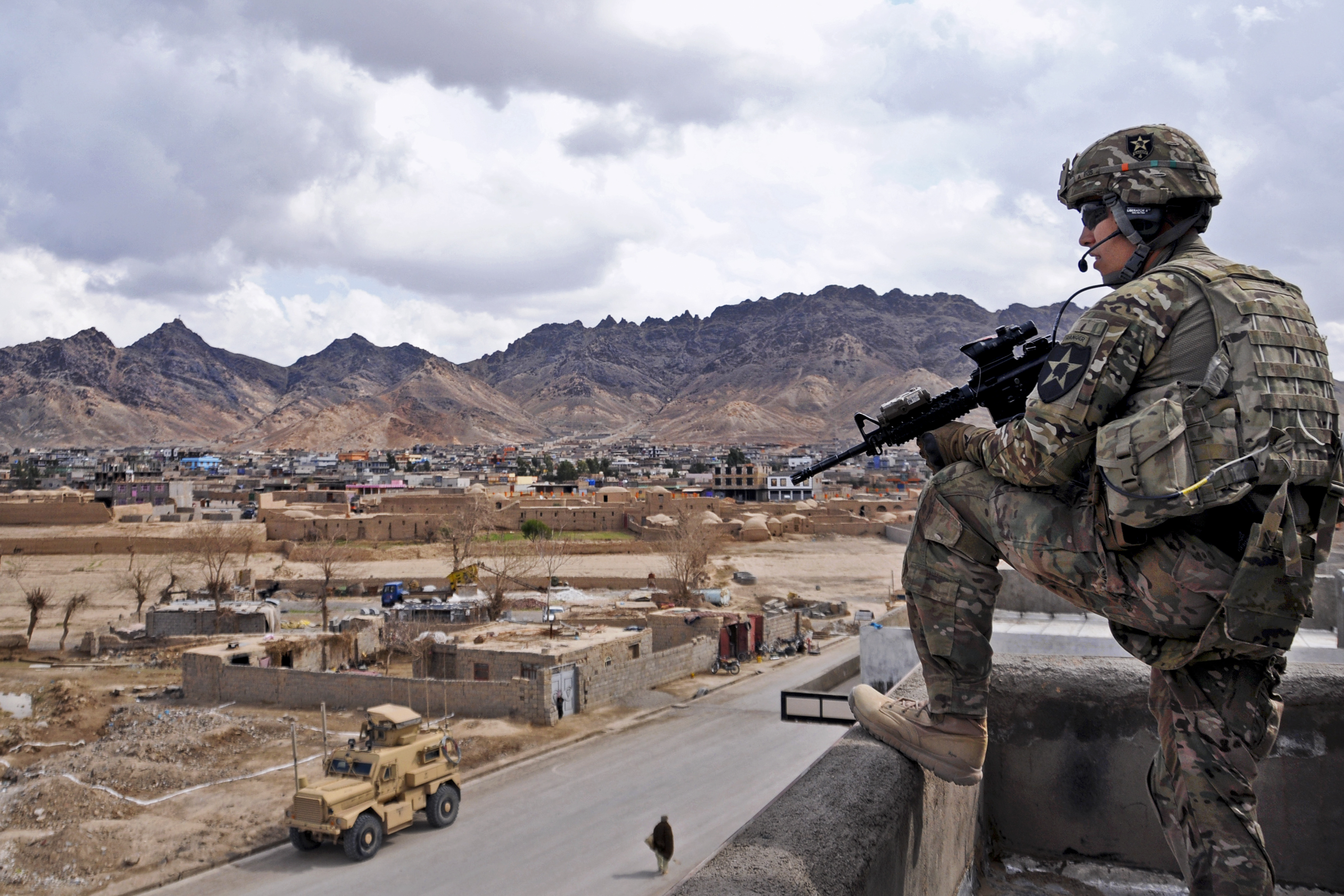 U.S. Army 1st Lt. Robert Wolfe, security force platoon leader for Provincial Reconstruction Team (PRT) Farah, provides rooftop security during a key leader engagement in Farah City, Feb. 25. U.S. Navy photo by Lt. j.g. Matthew Stroup