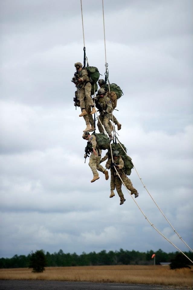An Operational Detachment Alpha from 7th Special Forces Group (Airborne) (7 SFG (A)) begin to be lifted off the ground by a CH-47 Chinook helicopter during a training event Eglin Base Air Force Base, Fla., Feb. 5, 2013. Green Berets from 7SFG (A) participated in a training event in which they practiced Special Purpose Insertion Extraction (SPIE). Spies are used to rapidly insert or extract soldiers from terrain that does not allow helicopters to land. (U.S. Army photo by Spc. Steven Young/Released)