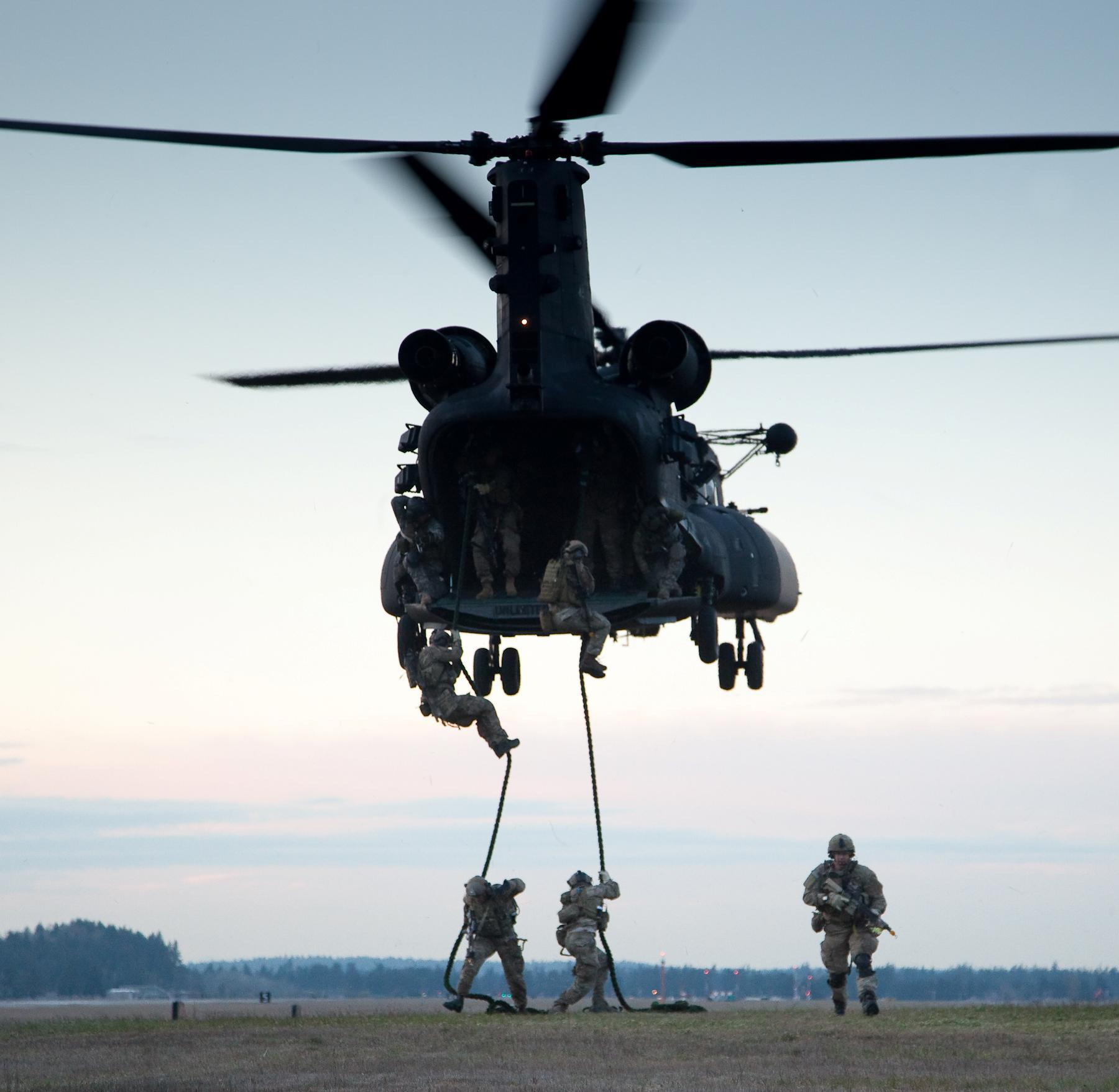 Rangers from B Company, 2nd Battalion, 75th Ranger Regiment, practice Fast Rope Insertion and Extraction (FRIES) out of an MH-47 from the 160th Special Operations Aviation Regiment during 2nd Battalion's Task Force Training at Joint Base Lewis-McCord, Wash., March 27, 2013. U.S. Army photo by Pfc. Connor Mendez