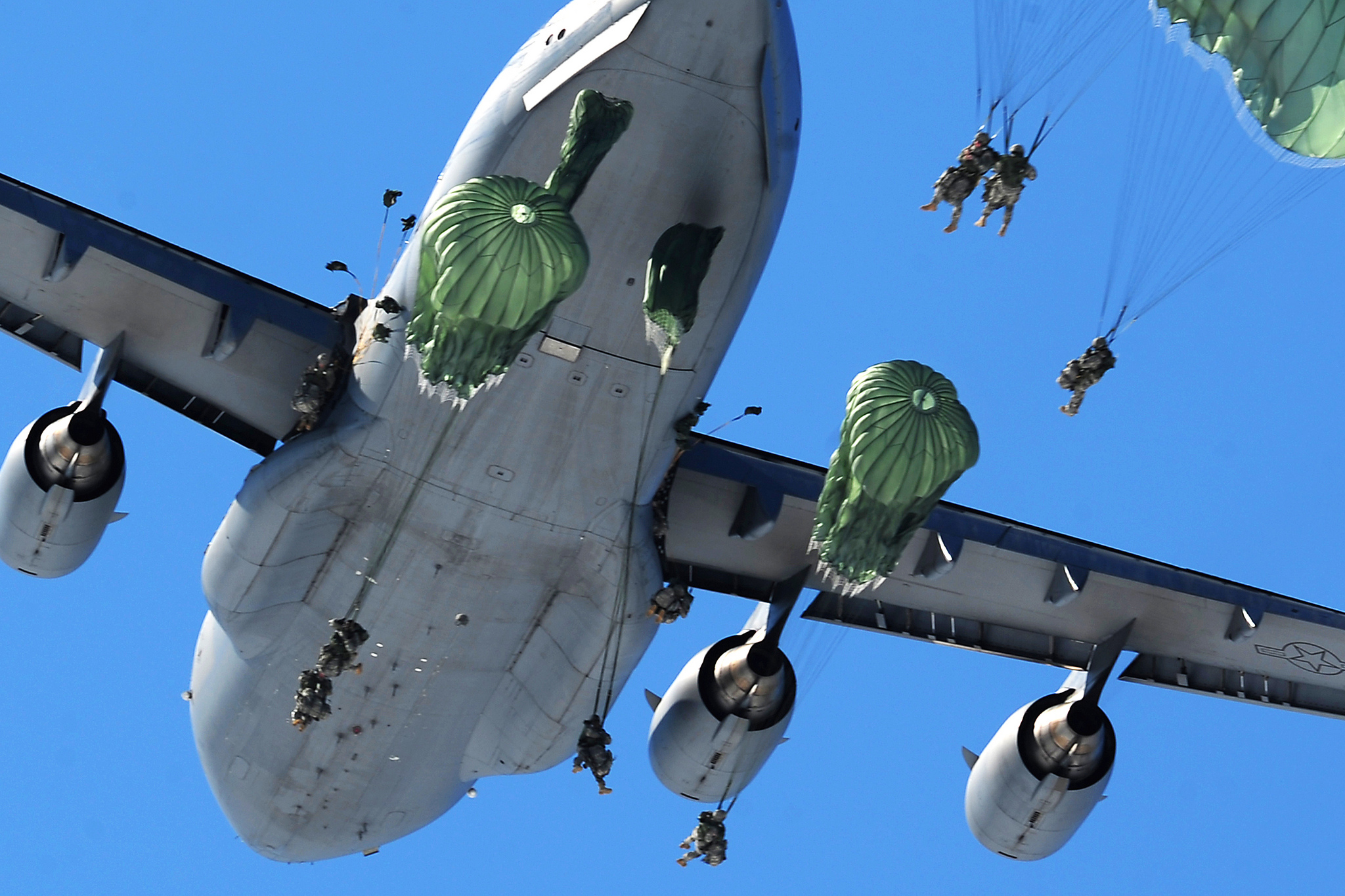 Soldiers assigned to U.S. Army Alaska's 425th Brigade Special Troops Battalion airdropped a Humvee on JBER's Malamute Drop Zone, followed by approximately 60 paratroopers from a C-17 aircraft, Wednesday, April 17, 2013. The paratroopers of the 4th Brigade Combat Team (Airborne) 25th Infantry Division recently completed post-deployment RESET, and are transitioning the brigade to assuming part of the quick reaction force mission for the Pacific theater. (U.S. Air Force photo/Justin Connaher)