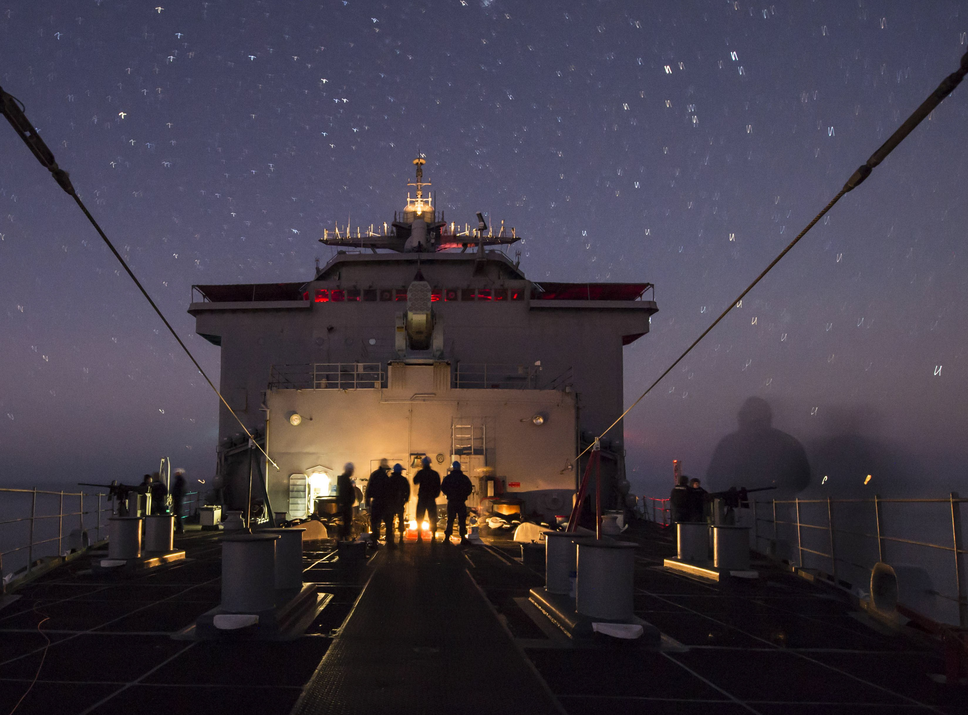 STRAIT OF GIBRALTAR (Dec. 26, 2014) Sailors aboard the Whidbey Island-class amphibious dock landing ship USS Fort McHenry (LSD 43) prepare the ship's forecastle for an eastbound transit of the Strait of Gibraltar. Fort McHenry, part of the Iwo Jima Amphibious Ready Group is conducting naval operations in the U.S. 6th Fleet area of responsibility in support of U.S. national security interests in Europe. (U.S. Navy Photo by Mass Communication Specialist 3rd Class Adam Austin/Released)