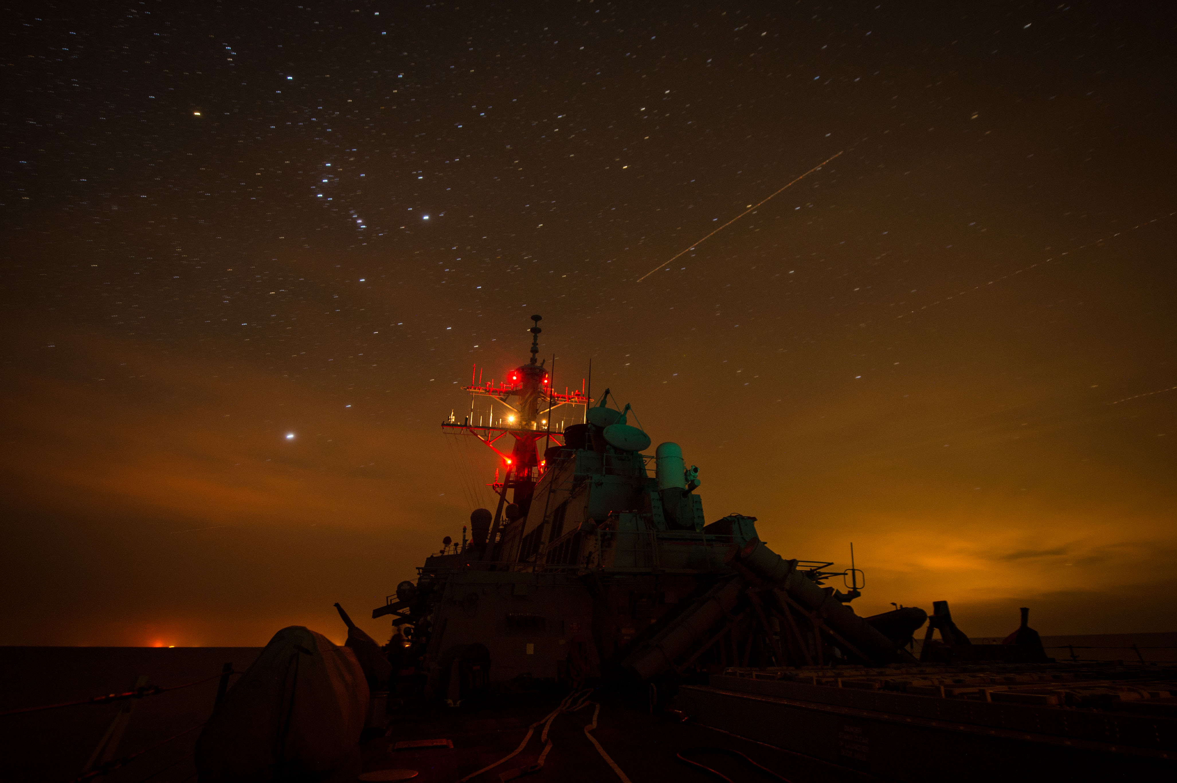 ARABIAN GULF (Dec. 15, 2014) The guided-missile destroyer USS Mitscher (DDG 57) lights up its mast during night delayed landing qualifications with the Desert Hawks of Helicopter Sea Combat Squadron (HSC) 26. Mitscher is deployed in the U.S. 5th Fleet area of responsibility supporting Operation Inherent Resolve, strike operations in Iraq and Syria as directed, maritime security operations, and theater security cooperation efforts in the region.(U.S. Navy photo by Mass Communication Specialist 2nd Class Anthony R. Martinez/Released)