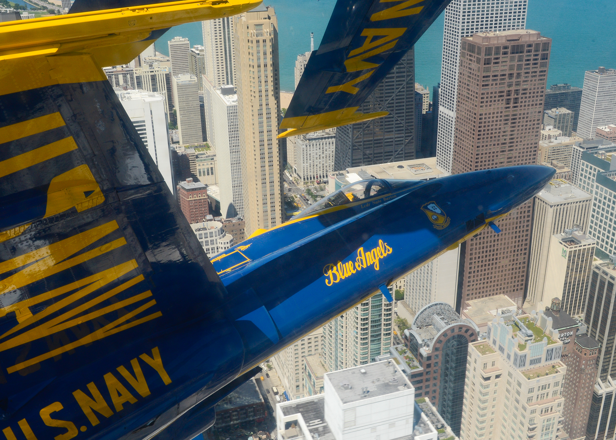 CHICAGO (Aug 14, 2014) Left wing pilot Lt. Cmdr. Nate Barton, assigned to the U.S. Navy flight demonstration squadron, the Blue Angels, flies above Chicago during a practice demonstration in preparation for the Chicago Air and Water Show, scheduled for Aug 16 and 17. The Blue Angels are scheduled to perform 68 demonstrations at 34 locations across the U.S. in 2014. (U.S. Navy photo by Mass Communication Specialist 1st Class Michael Lindsey/Released)