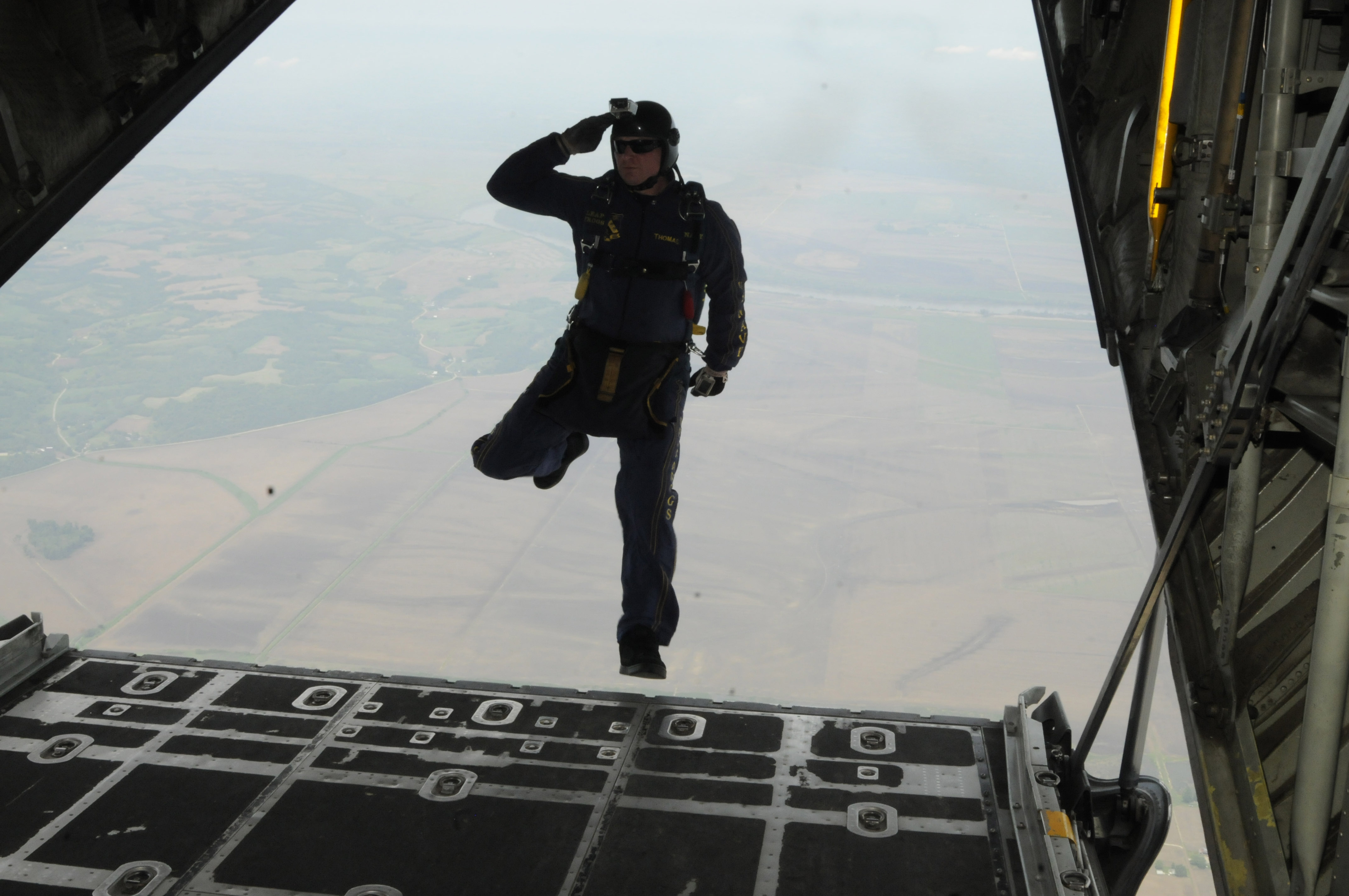 ST. JOSEPH, Mo. (May 4, 2012) Aircrew Survival Equipmentman 1st Class Thomas Kinn, assigned to the U.S. Navy parachute demonstration team, the Leap Frogs, salutes as he steps off the ramp of a C-130 Hercules aircraft assigned to the 139th Airlift Wing of Missouri Air National Guard during the Sound of Speed Air Show rehearsal at Rosecrans Memorial Airport. The Leap Frogs are based in San Diego and perform aerial parachute demonstrations in support of Naval Special Warfare and Navy recruiting. (U.S. Navy photo by Mass Communication Specialist 1st Class Michelle Turner/Released)