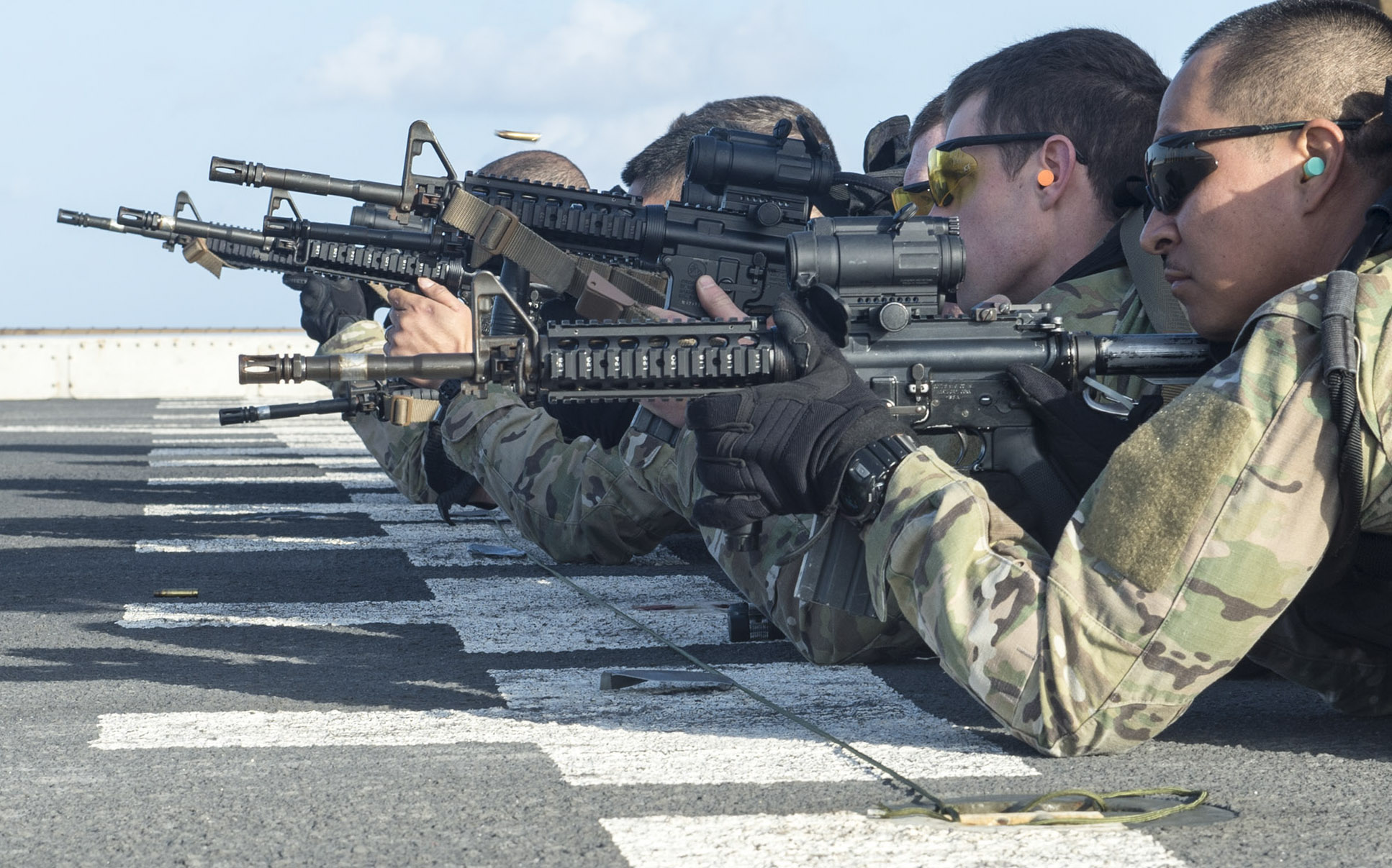 ATLANTIC OCEAN (Dec. 24, 2014) Members of the visit, board, search and seizure team of the San Antonio-class amphibious transport dock ship USS New York (LPD 21) participate in a live-fire exercise with the Marine Reconnaissance Force, 2nd Marine Expeditionary Force, 24th Marine Expeditionary Unit (24th MEU) on the ship's flight deck. New York, part of the Iwo Jima Amphibious Ready Group is conducting naval operations in the U.S. 6th Fleet area of responsibility in support of U.S. national security interests in Europe. (U.S. Navy photo by Mass Communication Specialist 3rd Class Jonathan B. Trejo/Released)