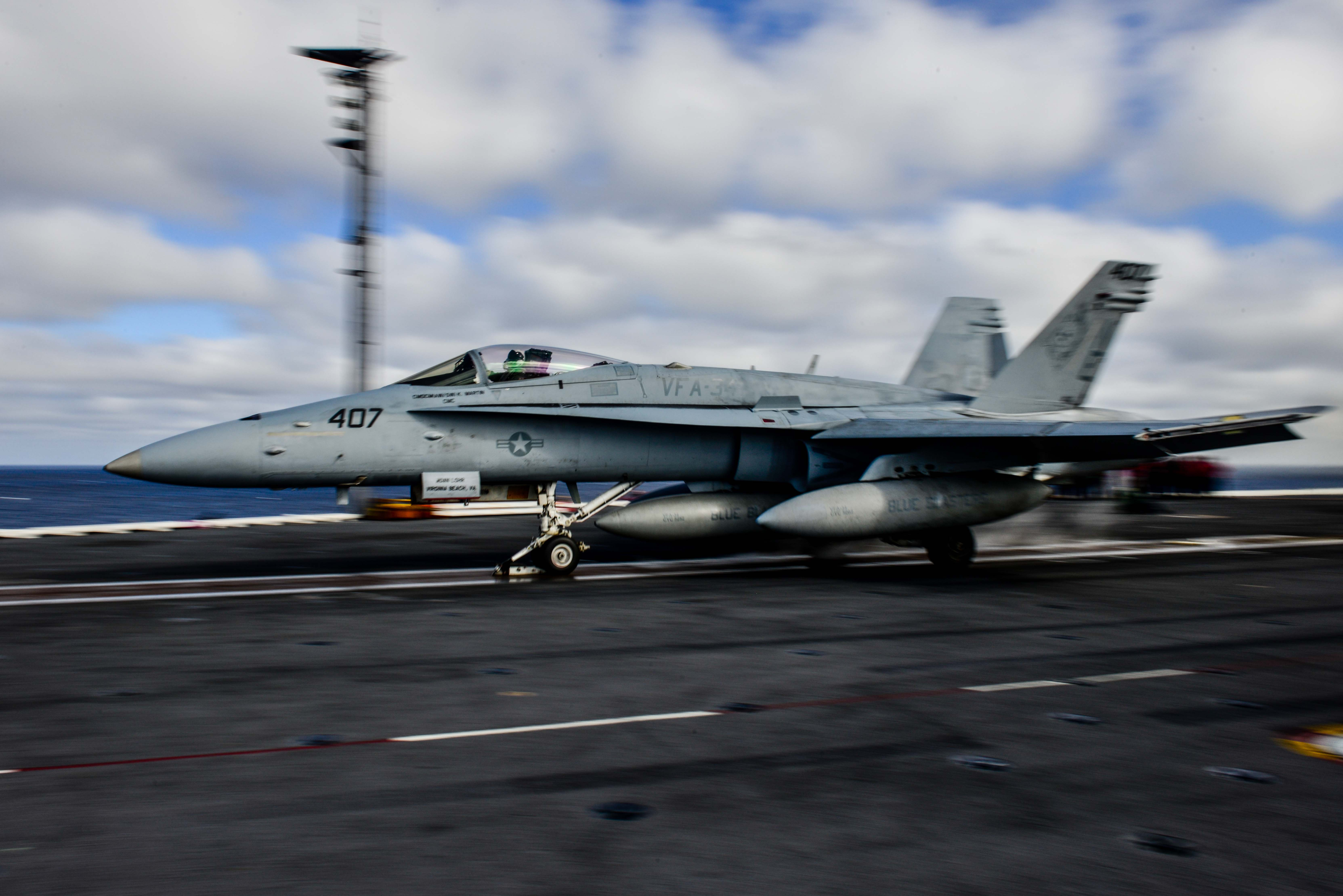 PACIFIC OCEAN (Dec. 9, 2014) An F/A-18C Hornet from the Blue Blasters of Strike Fighter Squadron (VFA) 34 is the first aircraft to launch from the flight deck of the Nimitz-class aircraft carrier USS John C. Stennis (CVN 74) since April 2013. John C. Stennis is undergoing an operational training period in preparation for future deployments. (U.S. Navy photo by Mass Communication Specialist 3rd Class Ignacio D. Perez/Released)