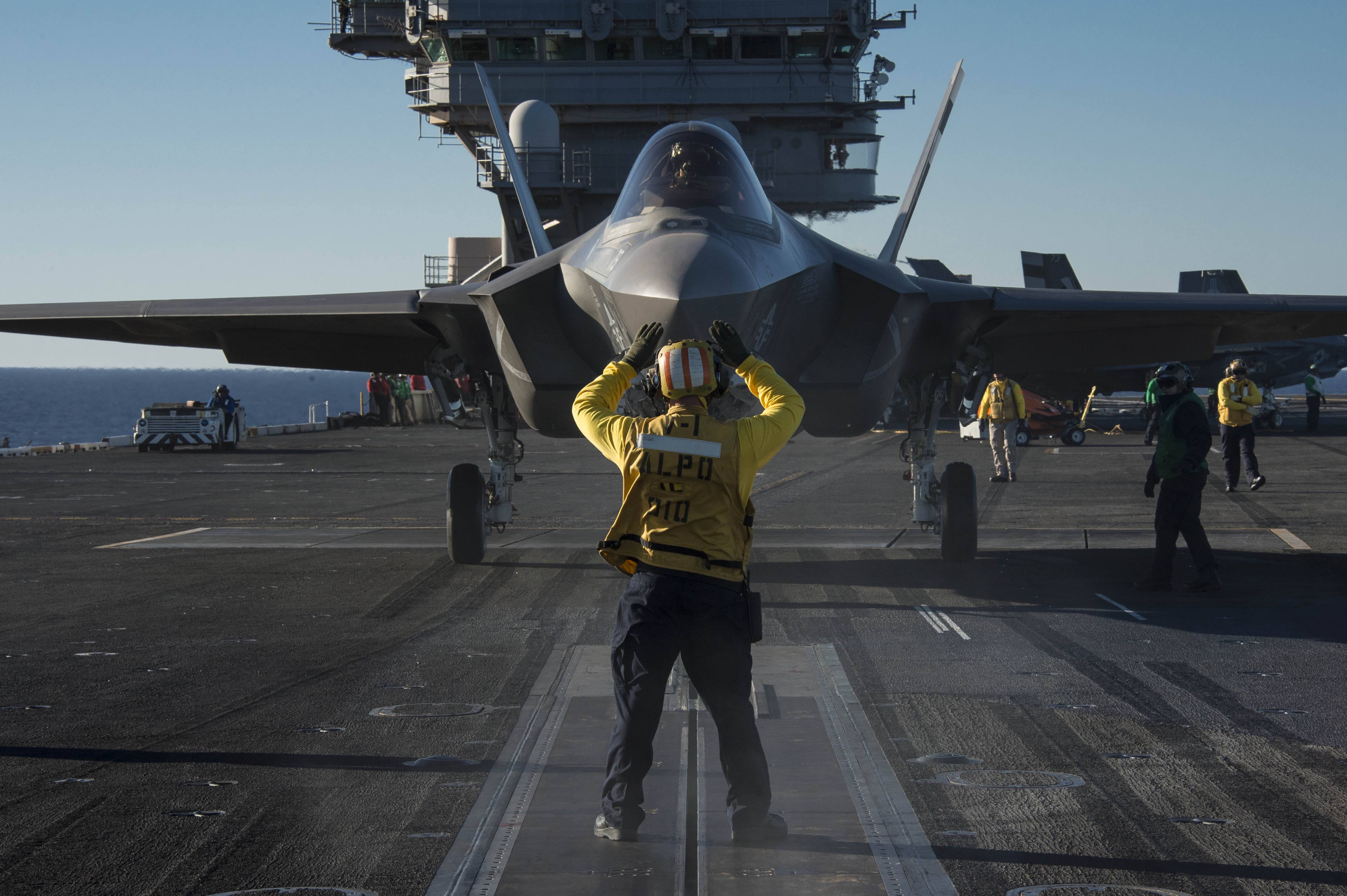 PACIFIC OCEAN (Nov. 4, 2014) An F-35C Lightning II carrier variant joint strike fighter is prepared for launch aboard the aircraft carrier USS Nimitz (CVN 68). The F-35 Lightning II is undergoing initial at-sea trials aboard Nimitz. (U.S. Navy video by Mass Communication Specialist 1st Class Brett Cote/Released)