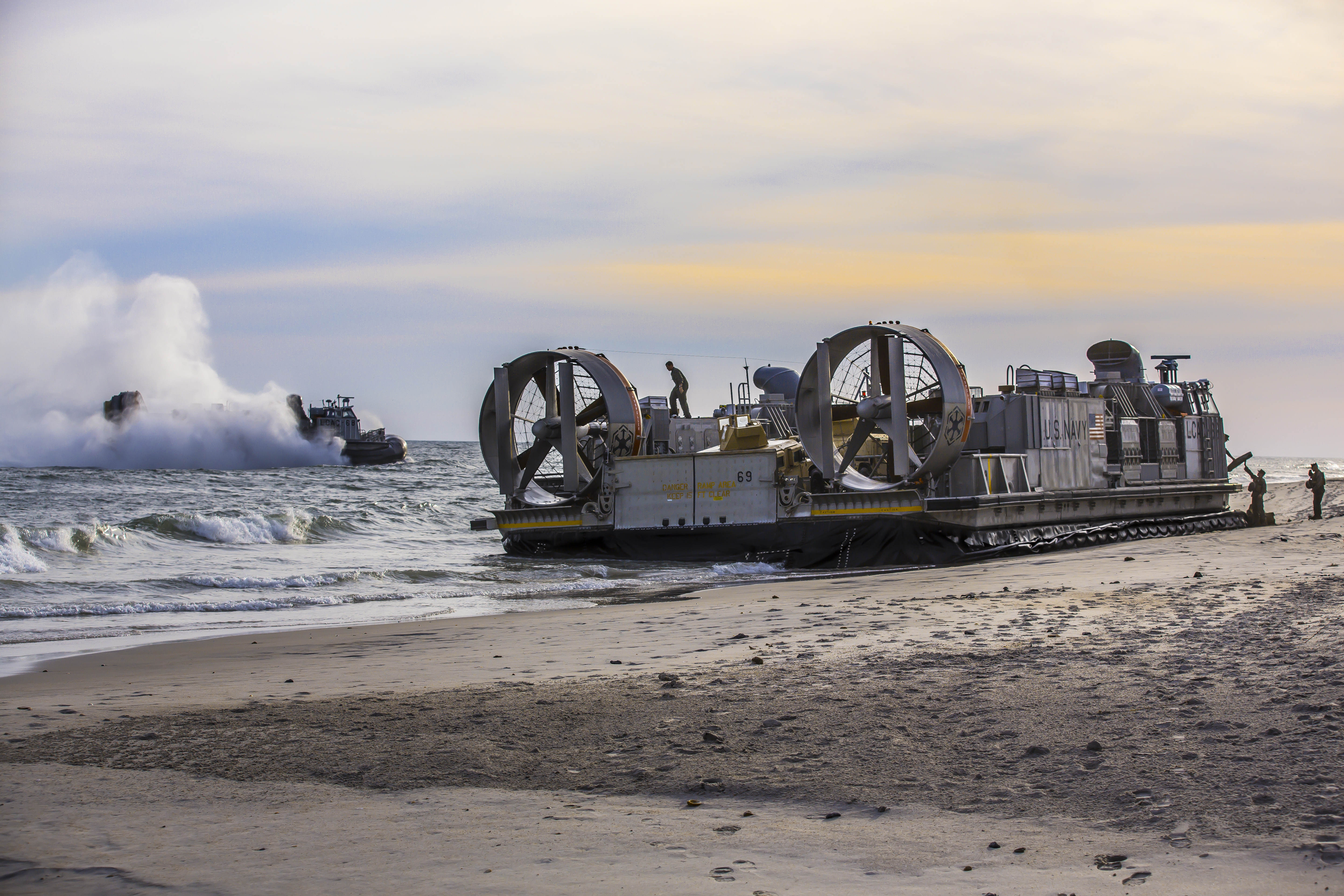 CAMP LE JEUNE, N.C. (Nov. 4, 2014) Marines disembark landing craft air cushion (LCAC) vehicles at Camp Le Jeune, N.C. during the multinational exercise Bold Alligator 2014. Bold Alligator is intended to improve Navy and Marine Corps amphibious core competencies. Working with coalition, NATO, allied and partner nations is a necessary investment in the current and future readiness of our forces. The exercise takes place Oct. 29 - Nov. 10, 2014, afloat and ashore along the Eastern seaboard. #BoldAlligator14 (U.S. Navy photo by Mass Communication Specialist 2nd Class Corbin J. Shea/Released)