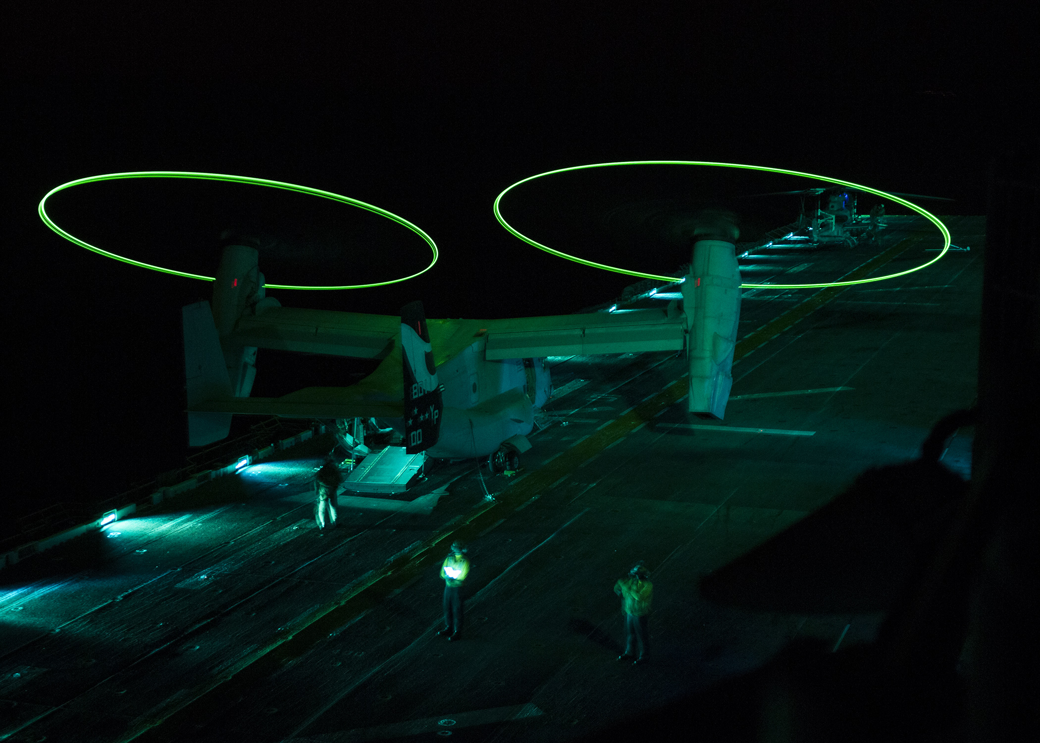 ARABIAN GULF (Sept. 18, 2014) An MV-22 Osprey displays static lights while performing operational testing during night vision device flight operations aboard the amphibious assault ship USS Makin Island (LHD 8). Makin Island is the flagship of the Makin Island Amphibious Ready Group and, with the 11th Marine Expeditionary Unit (11th MEU), is deployed in support of maritime security operation and theater security cooperation efforts in the U.S. 5th Fleet area of responsibility. (U.S. Navy photo by Mass Communication Specialist 3rd Class Robin W. Peak/Released)