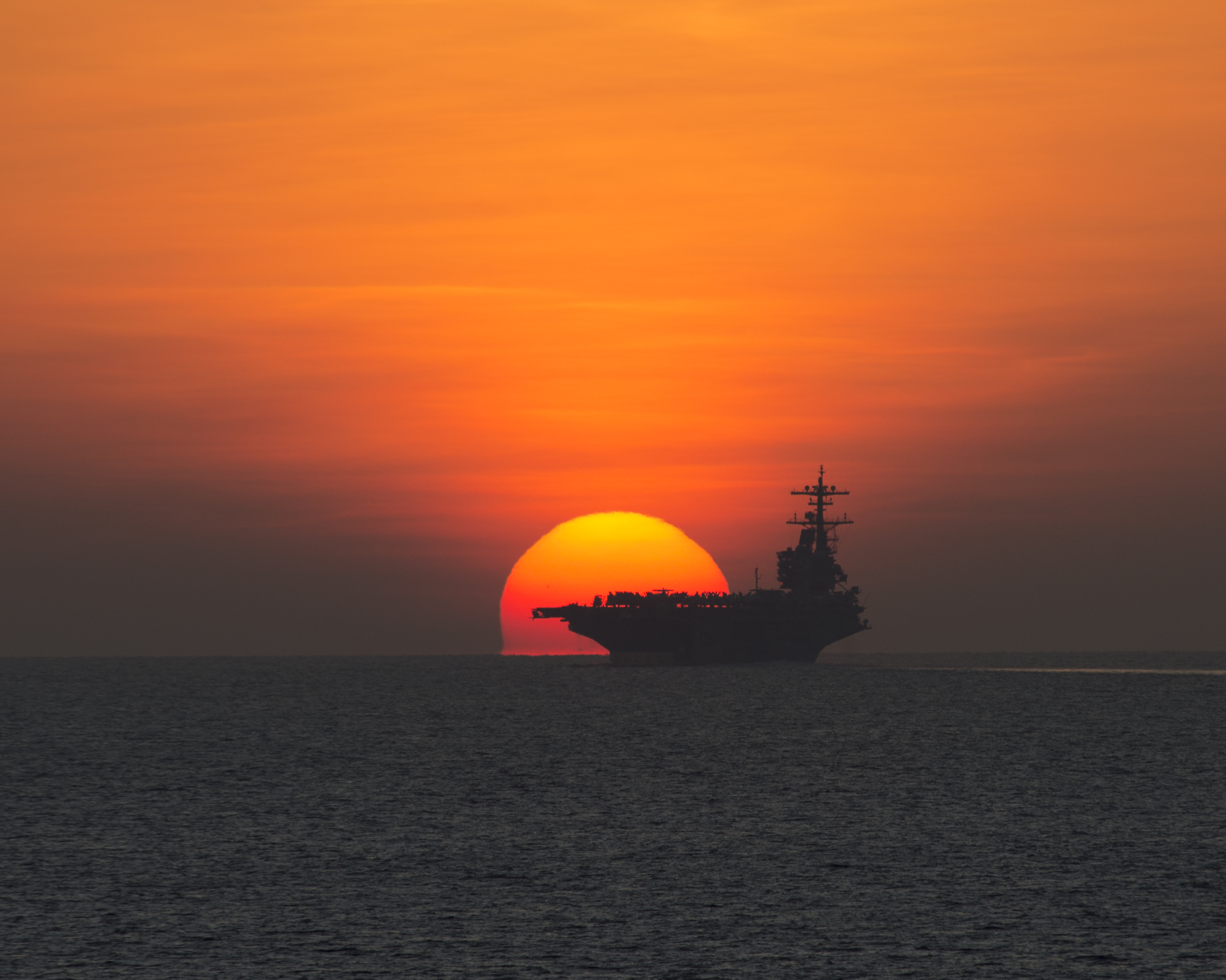 GULF OF ADEN (Oct. 23, 2014) The aircraft carrier USS George H.W. Bush (CVN 77) transits the Gulf of Aden. The George H.W. Bush Carrier Strike Group is returning to Naval Station Norfolk after supporting maritime security operations, strike operations in Iraq and Syria as directed, and theater security cooperation efforts in the U.S. 5th Fleet area of responsibility. (U.S. Navy photo by Mass Communication Specialist 2nd Class Abe McNatt/Released)