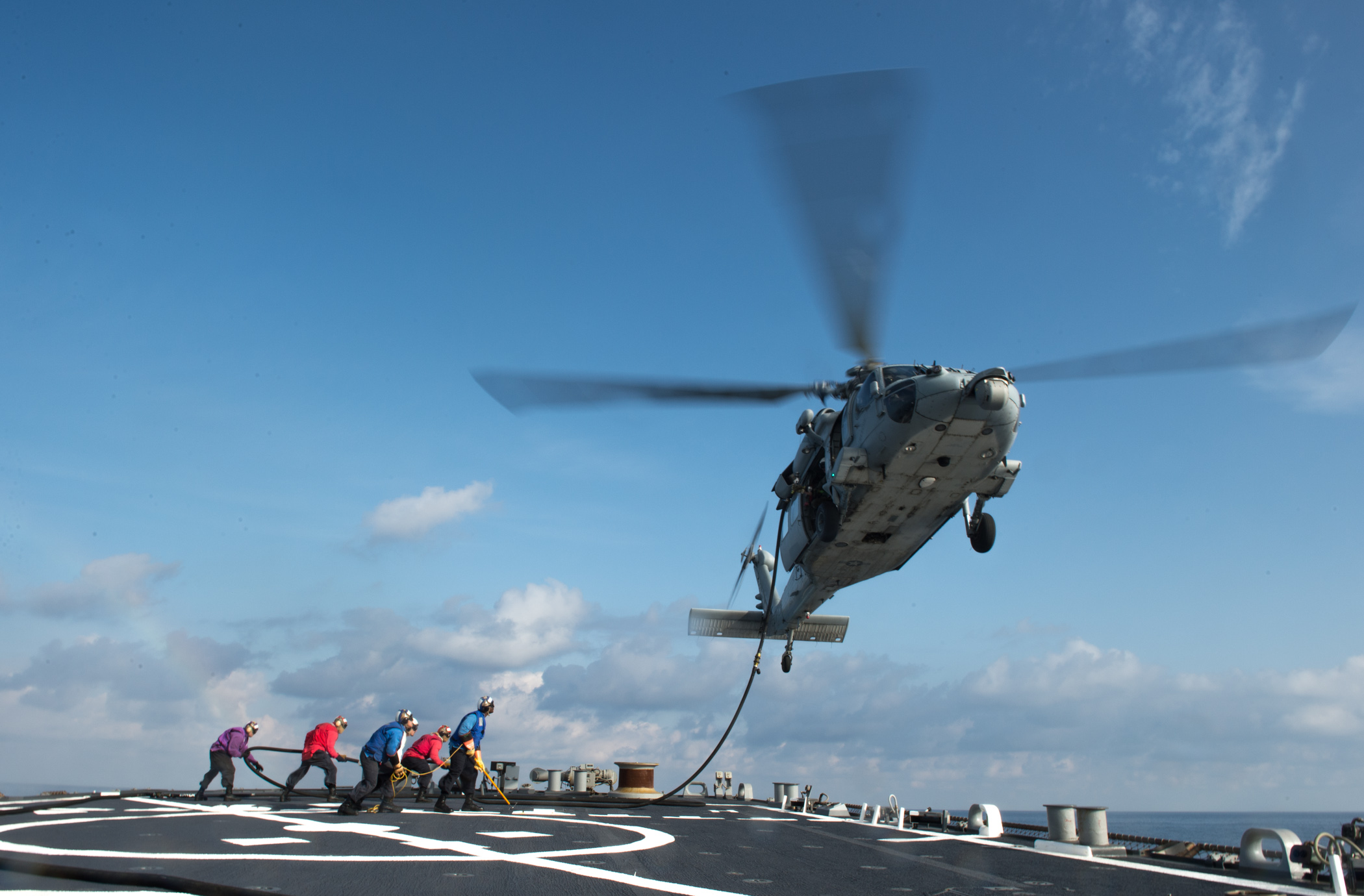 MEDITERANNEAN SEA (Nov. 24, 2014) Sailors from the Arleigh Burke-class guided-missile destroyer USS Donald Cook (DDG 75) perform a hot in-flight refueling with an MH-60S helicopter from the Dragon Whales of Helicopter Sea Combat Squadron (HSC) 28 during flight quarters. Donald Cook, homeported in Rota, Spain, is conducting naval operations in the U.S. 6th Fleet area of responsibility in support of U.S. national security interests in Europe. (U.S. Navy photo by Mass Communication Specialist 2nd Class Karolina A. Oseguera/Released)