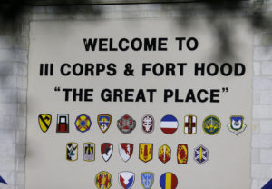The main entrance of the Army base is shown where the the start of the court-martial of Maj. Nidal Malik Hasan is taking place Tuesday, Aug. 6, 2013, in Fort Hood, Texas. After years of delays, the trial of the man who carried out the Fort Hood shooting is starting, with Hasan representing himself against charges of  murder and attempted murder for the 2009 attack that left 13 people dead on the Army post. (AP Photo/LM Otero)