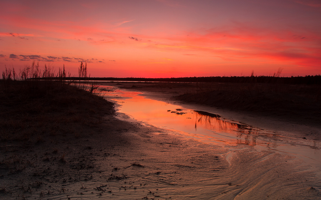 """Singing Sands Sunset, Runoff Reflections"" by Ted Kaiser via Flickr Creative Commons"