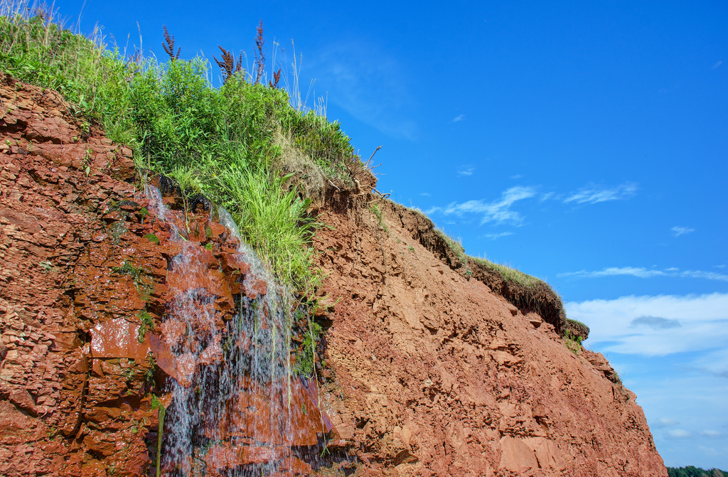 """ Red Earth, Sky and Water at Argyle Shore Provincial Park PEI"" by Jamie McCaffrey via Flickr Creative Commons"