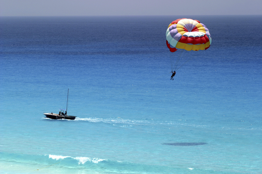 """Parasailing over the Water of the Riviera Maya"" by Grand Velas Riviera Maya via Flickr Creative Commons"