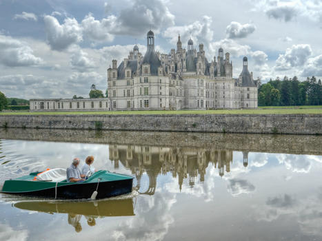 Travel over 50  old couple grandmother and grandfather travel together by boat in loire france