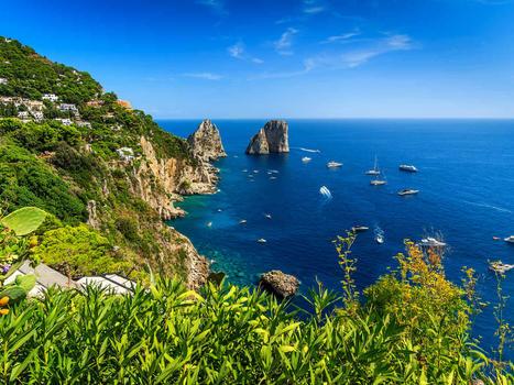 Sailing  faraglioni cliffs panoramaand the stunning tyrrhenian seacapri islandcampaniaitalyeurope
