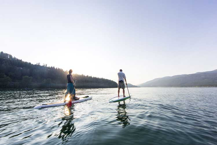 The clear waters of Whitefish Lake and the mellow Whitefish River are a paddling playground. Photo © ChuckHaney.com / Whitefish CVB