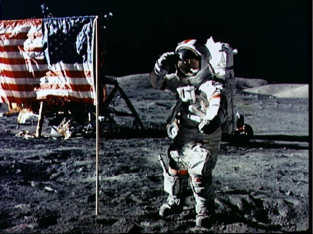 """Astronaut Eugene Cernan Salutes Deployed U.S. Flag on Lunar Surface"" by NASA Goddard Space Flight Center"