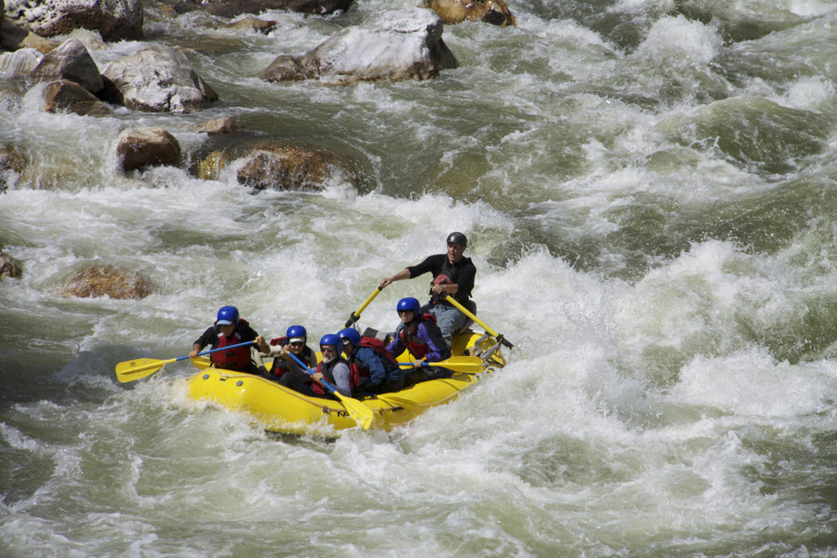 """Rapid on the Paro Chhu"" by Zachary Collier via Flickr Creative Commons"