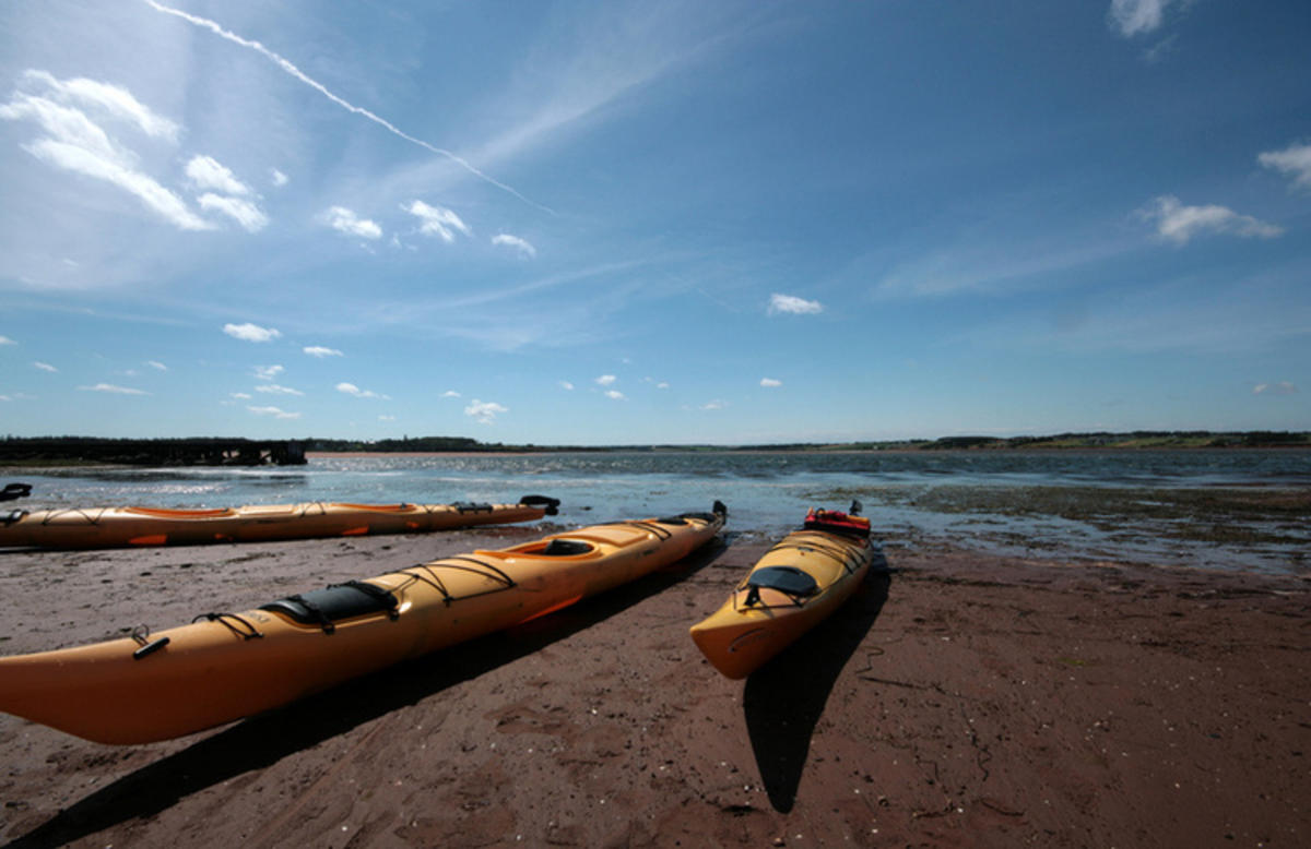 """Kayaks in North Rustico"" by Arlen Tees via Flickr Creative Commons"
