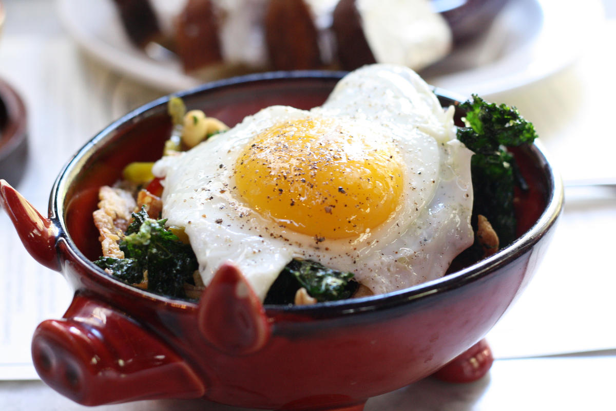 """Pig's Ear with Crispy Kale, Pickled Cherry Peppers and a Fried Egg"" by esimpraim via Flickr Creative Commons"